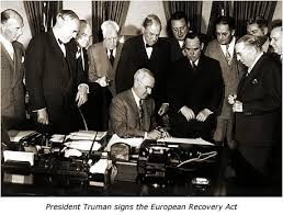 President-Truman-signs-European-Recovery-Act